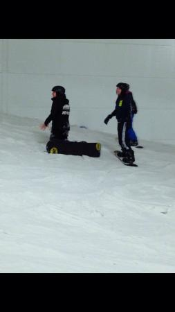 Trying not to fall over at xscape on a snowboarding lesson
