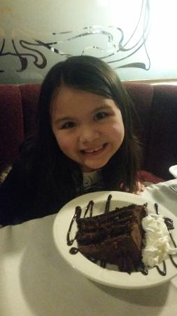 "Red Gables Mesquite Grill: Bella is ready to eat her chocolate cake from the ""Red Gable"""