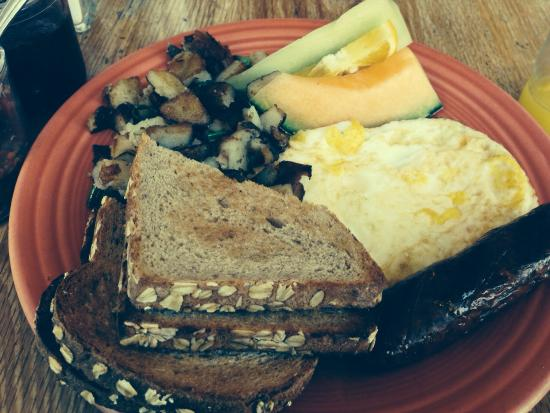 Mama's Royal Cafe: Home fried potatoes with turkey sausage and eggs and wheat toast