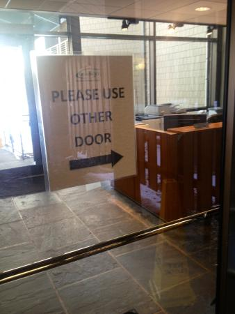 "Chauncey Conference Center: ""Please use other door"" Other = not handicapped"