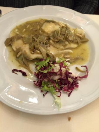Girarrosto Fiorentino : Turbot fish with artichoke and pine nuts