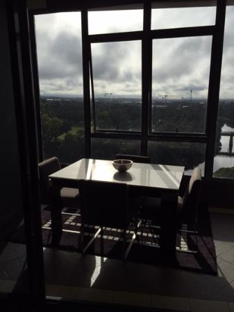 Meriton Suites George Street, Parramatta: enclosed balcony with dining table