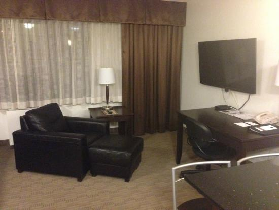 Living area of suite, Place Louis Riel Suite Hotel  |  190 Smith Street, Winnipeg, Manitoba R3C