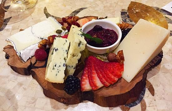 Motif Restaurant at St. Regis: Five perfect cheeses on an olive wood board matched with a perfect wine.