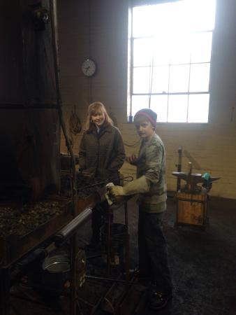The Speckled Trout Bed and Breakfast: Kay with our son learning a bit about blacksmithing after escorting us to the blacksmithing shop