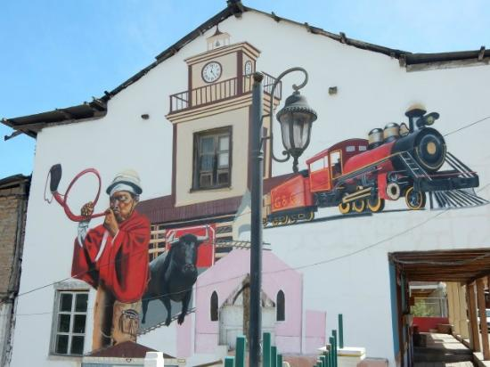 Hotel Europa: A mural on the side of a building in Alausi, Ecuador