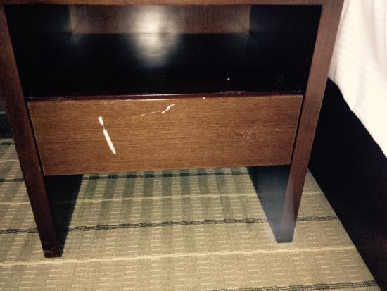 Hotel Casino New Brunswick: Damage to nightstand