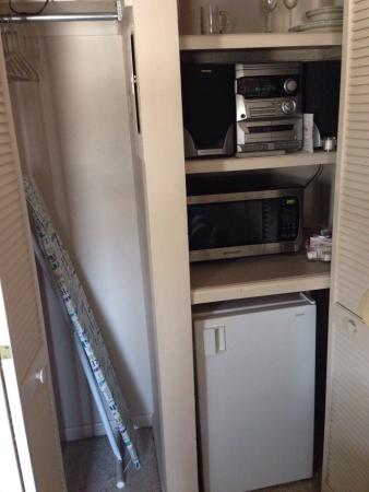 East Greenville, PA: Pantry with refrigerator microwave stereo iron $ ironing board.
