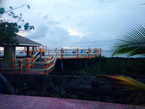 Seagrape Plantation Resort: Front proch of bungalow-old reef borders waterfront