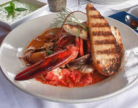 Pilgrim's Inn: Seafood stew, featuring our world famous lobsters