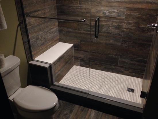 Interesting/nice barnwood finish tile used in the bath and roon ...