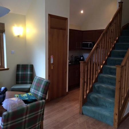 Luxury Woodland Lodges at Macdonald Aviemore Resort: kitchen with stairs going up to third bedroom