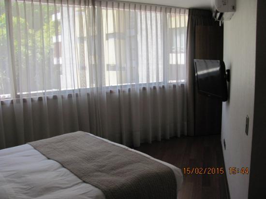 Time Apartments: quarto aconchegante