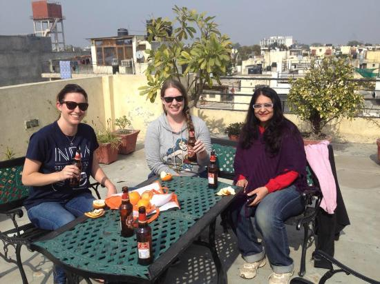 Grace Home : Sharing a Kingfisher on the rooftop. Great for group meetings!