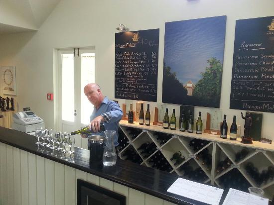 Palliser Estate Winery: Malcolm,  pouring tastes for visitors.