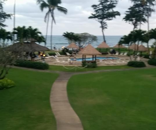 View from Lanai rm 208. Live musicians playing by bar and tiki torches, very romantic