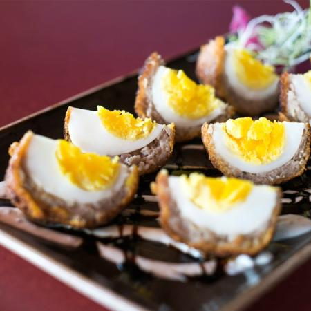 Tetherow Grill: Scottish eggs -- eggs wrapped in sausage, breaded and fried.