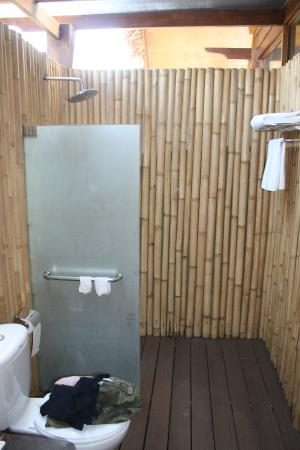 Partially open bathroom picture of the gemalai village for Village bathroom photos