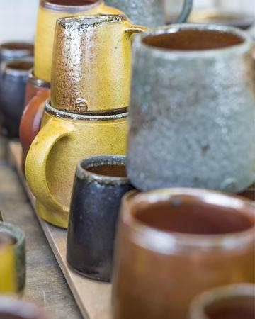 Soda fired mugs at the Leach Pottery
