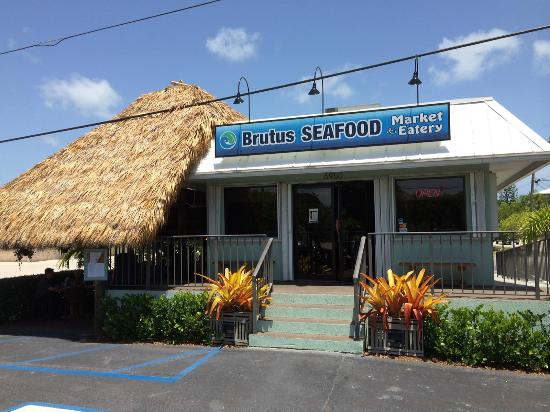 Brutus Seafood Market & Eatery: Dine inside in the air conditioner or outside under our tiki.