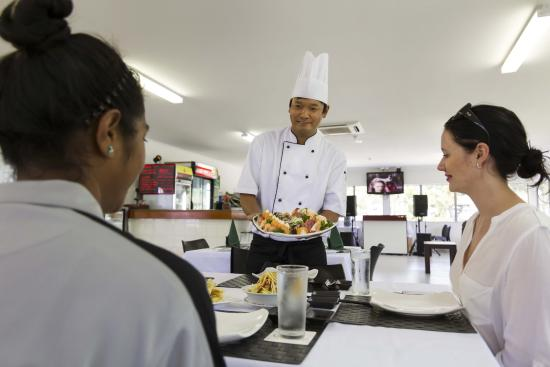 Crossroads  Hotel: Chef with Customers and Sushi Plate