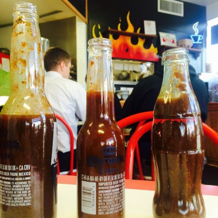 The Lunch Box Deli & BBQ: 3 house-made BBQ sauces, served warm in cute Corona bottles :)