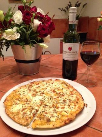 Secret Garden Bistro: What better than a delicious glass of wine & garlic pizza