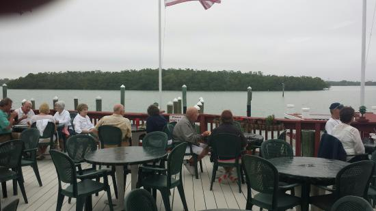 Old Marco Lodge Crab House: Dining on the deck with a view of Marco River