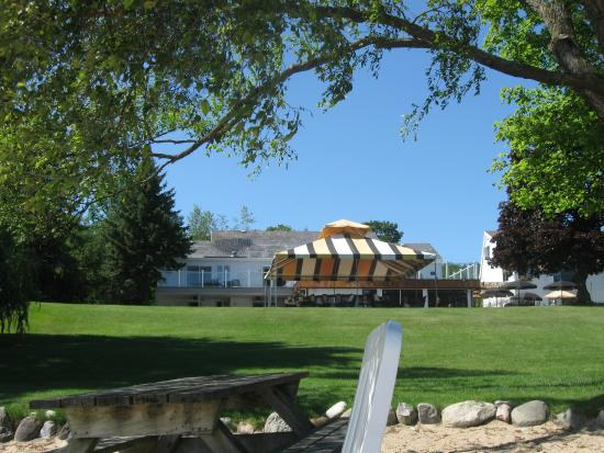 The Vineyard Inn on Suttons Bay: View from the beach area toward the rooms