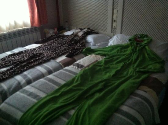Hostel Micolau: Our onsies holding hands thanks to housekeeping :)