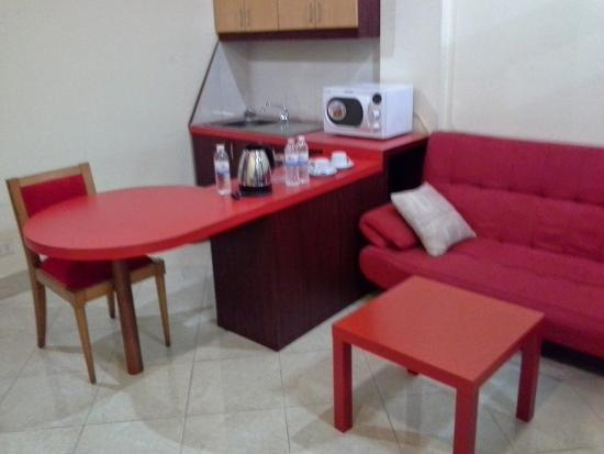 New Rose Boutique Hotel: The room's living area with combination dining table & microwave oven etc