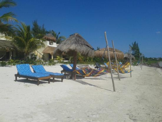Relax in a hammock or beach chair at Maya Luna beach