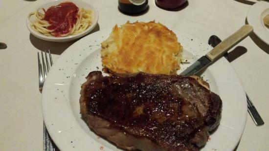 Anthony's Restaurant & Lounge: Anthony's Prime Cut Steak with hash browns and spaghetti.