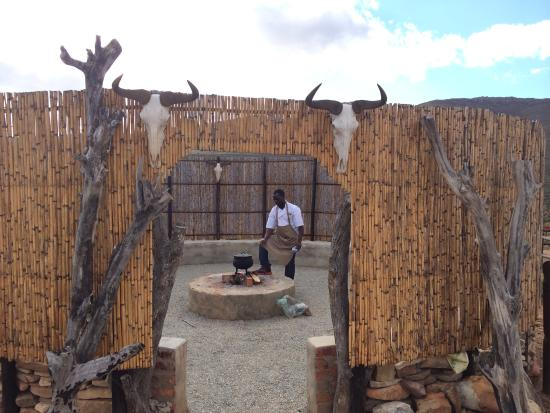 African Game Lodge: Chef Preparing Potjie in the Boma