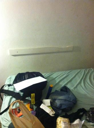 Lafayette Motel: Sorry excuse for a headboard... what's the point?