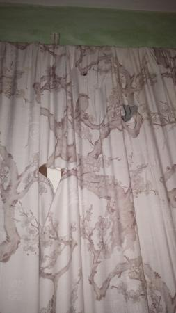 Mariposa Hideaway: Dirty, stained and ripped down curtains