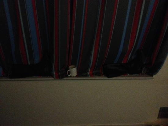 Travelodge Maidenhead Central Hotel: Boots were used to stop the light coming in around the curtains