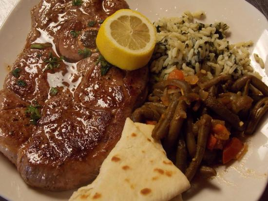 Ancient Pillars Greek Restaurant: Leg of lamb steak dinner platter; available every Friday night!!! Juicy, yummy, off menu and not