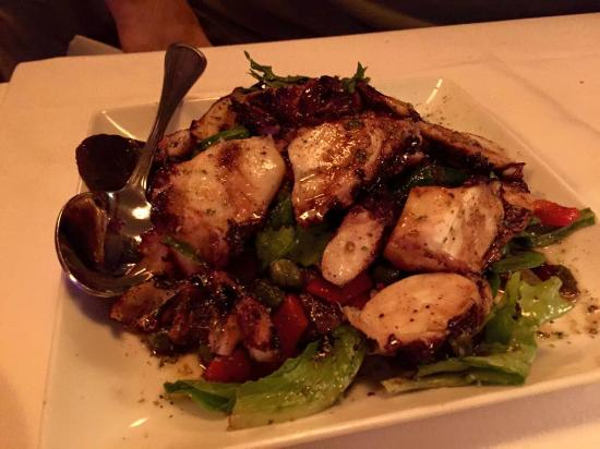 Christos Steak House: Charred octopus with roasted red peppers, capers & red wine dressing the (best I ever had, it wa