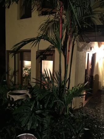 Frangipani Boutique Restaurant: Entrance at night
