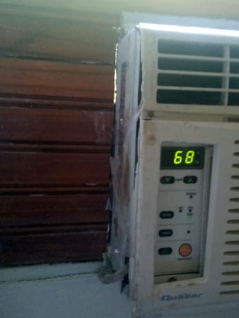 "Rio Lindo Resort: Air conditioner panel ""fixed"" with peeling plastic tape"