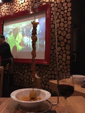 Chicken Skewers with FC Barcelona in the background