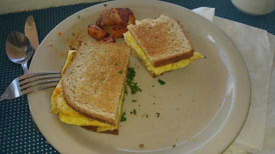 Jake's : Simple scrambled eggs and cheese sandwich on wheat, yum!