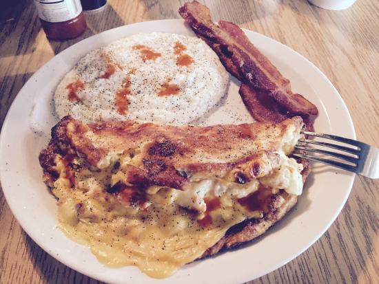 Coffee Break Cafe: Steak Omelette plate with side of bacon after i added hot sauce.
