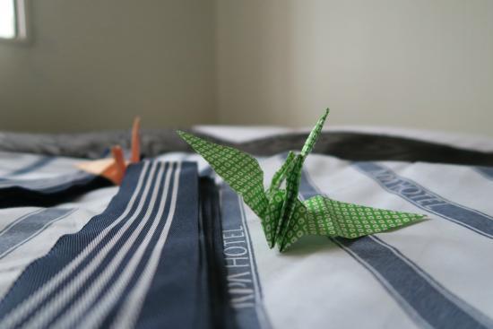 Apa Hotel Nagasaki Ekimae: Yukata in room with origami cranes, a charming touch