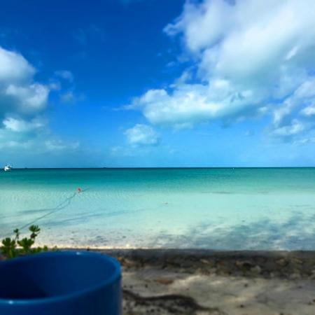C Shells Guest Quarters : Enjoy your morning coffee right on the water just steps from your room.