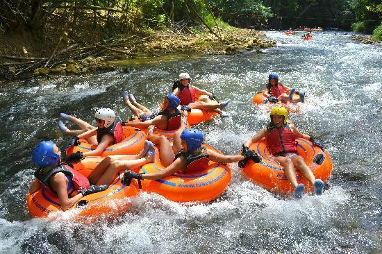 Jamaica Exquisite - Day Tours : Riding the waves in a tube down the Rio Bueno River Rapids Jamaica in Trelawny