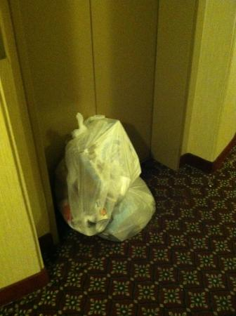 Penrose Hotel: Trash sat for at least 12 hours outside the elevator on our floor