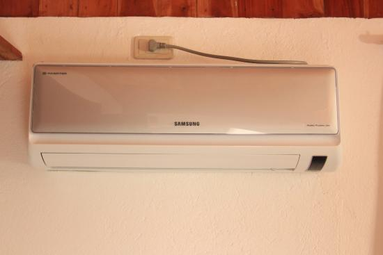 Wall mounted AC unit, quiet but blue light too bright during the ...