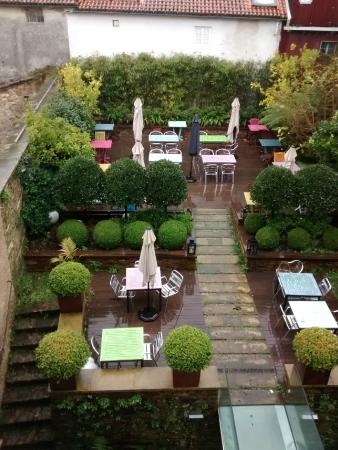 Terraza trasera con jard n picture of hotel gastronomico for Terrazas traseras